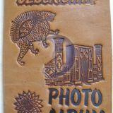 Кожаные сувениные фотоальбомы.