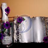 Dekoruootas butelis ir knyga