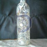 Graviruotas vyno butelis