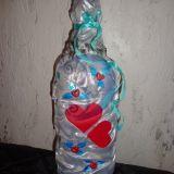 sidabrinis butelys su širdelėmis