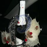 Šampanas sniego gniūžtėje