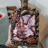 Puoštas brendžio butelis-dovana