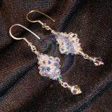 Nuostabus žerintys sidabriniai auskarai
